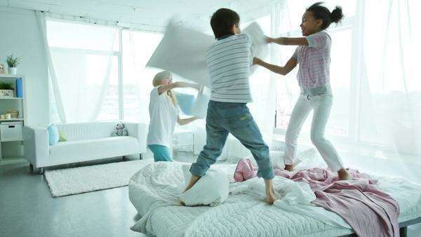 Children fighting with pillow